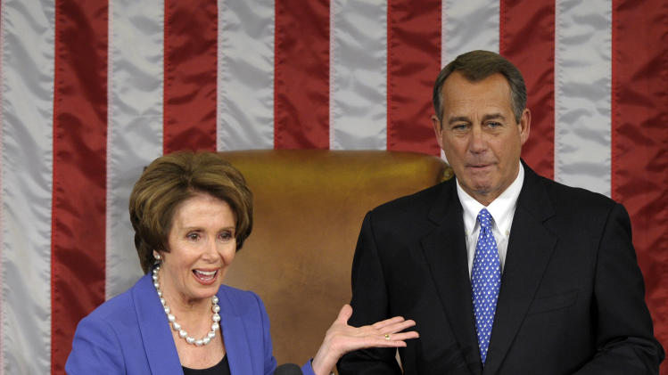 House Minority Leader Nancy Pelosi of Calif. gestures after passing the gavel House Speaker John Boehner of Ohio, who was re-elected as House Speaker of the 113th Congress, Thursday, Jan. 3, 2013, on Capitol Hill in Washington. (AP Photo/Susan Walsh)