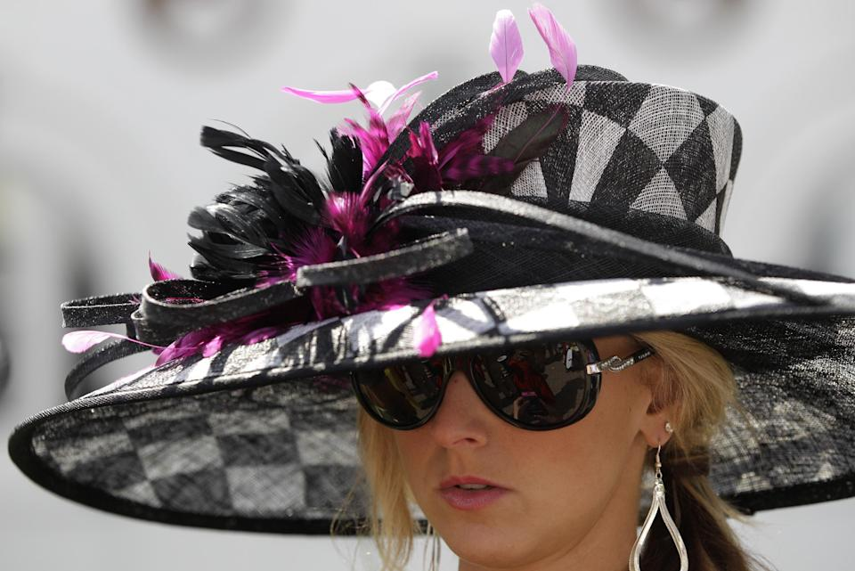 Sara Boucher, Frederickstown, Ohio wears a fancy hat in the paddocks before the 138th Kentucky Derby horse race at Churchill Downs Saturday, May 5, 2012, in Louisville, Ky. (AP Photo/Mark Humphrey)