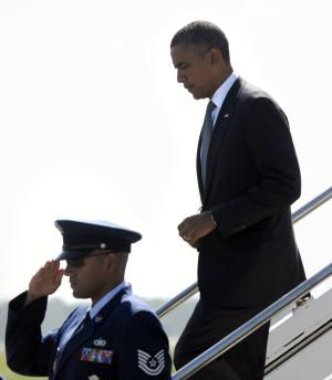 "President Barack Obama walks down the steps of Air Force One after arriving at Southwest Florida International Airport in Ft. Myers, Fla., Friday, July 20, 2012. Obama is cutting short a Florida campaign swing following the deadly Colorado movie theater shooting. He called the shooting ""horrific"". (AP Photo/Susan Walsh)"