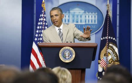 U.S. President Obama addresses reporters ahead of national security council meeting at the White House in Washington