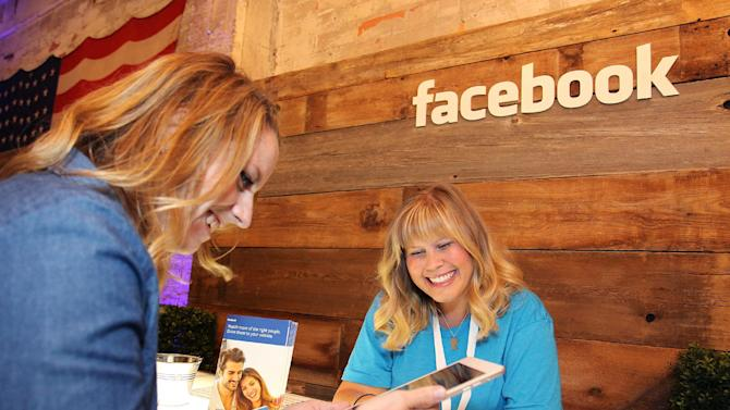 IMAGE DISTRIBUTED FOR FACEBOOK - A Facebook small business expert offers one-on-one feedback to an attendee during Boost Your Business Minneapolis at Aria on Thursday, July 30, 2015 in Minneapolis.  (Photo by Andy Clayton-King/Invision for Facebook(AP Images)