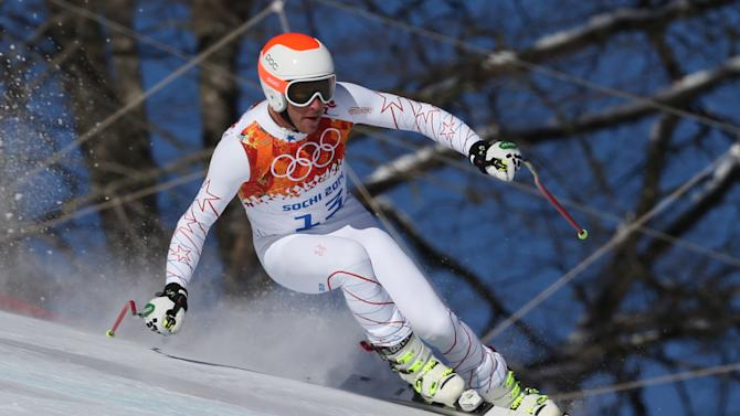 United States' Bode Miller makes a turn during men's downhill training at the Sochi 2014 Winter Olympics, Thursday, Feb. 6, 2014, in Krasnaya Polyana, Russia.(AP Photo/Luca Bruno)