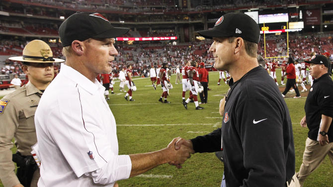San Francisco 49ers head coach Jim Harbaugh, right, shakes hands with Arizona Cardinals head coach Ken Whisenhunt after their NFL football game, Monday, Oct. 29, 2012, in Glendale, Ariz. The 49ers won 24-3. (AP Photo/Ross D. Franklin)