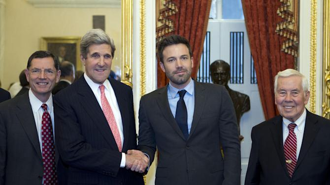 Sen. John Kerry D-Mass., shakes hands with actor Ben Affleck during a meeting with foreign relations members to discus the crisis in the Democratic Republic of Congo at Capitol Hill in Washington on Wednesday, Dec. 19, 2012. With them are Sen. John Barroso R-WY., left, and Sen. Richard Lugar R-IN, right. (AP Photo/Jose Luis Magana)