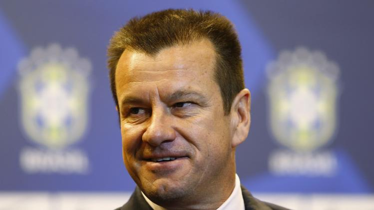 Brazil's new manager Dunga arrives at a news conference in Rio de Janeiro