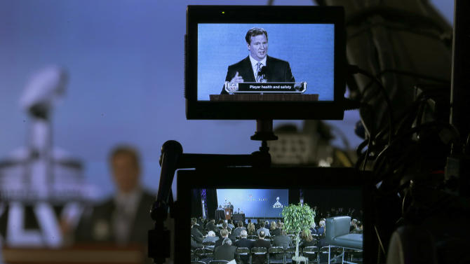NFL Commissioner Roger Goodell is seen on a television monitor as he answers questions during an NFL Super Bowl XLVII football game news conference at the New Orleans Convention Center, Friday, Feb. 1, 2013. in New Orleans. (AP Photo/Charlie Riedel)