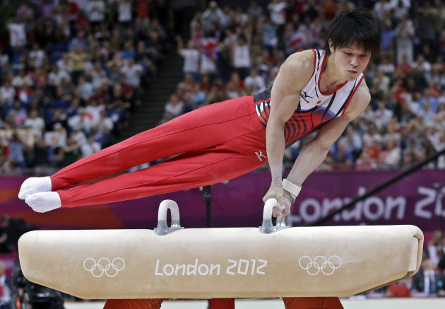 Japanese gymnast Kohei Uchimura performs on the pommel horse during the Artistic Gymnastic men's team final at the 2012 Summer Olympics, Monday, July 30, 2012, in London. After judges spent about five minutes reviewing three-time world champion Uchimura on the pommel horse, his score was revised and Japan was awarded the silver medal with Britain getting bumped down to bronze. (AP Photo/Julie Jacobson)
