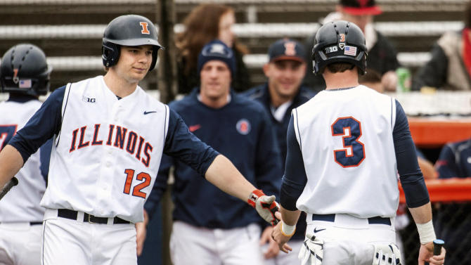 In this March 10, 2015, photo, Illinois right fielder Casey Fletcher (3) celebrates his run with teammate David Kerian (12) during an NCAA college baseball game against Chicago State in Champaign, Ill. Illinois coach Dan Hartleb knows how fast things can change in baseball, so he's not celebrating his team having the nation's longest active winning streak at 17 games.(Heather Coit/The News-Gazette via AP)