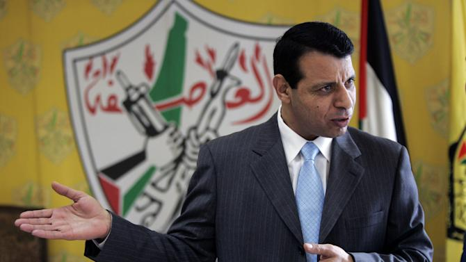 File - In this Jan. 3, 2011 file photo, Palestinian Fatah leader Mohammed Dahlan gestures as he speaks during an interview with The Associated Press in his office in the West Bank city of Ramallah. Banished in 2010 by Palestinian President Mahmoud Abbas, a former mentor, Dahlan has leveraged millions spent on needy Palestinians and his close ties with Egypt and the United Arab Emirates into growing political influence at home. (AP Photo/Majdi Mohammed, File)