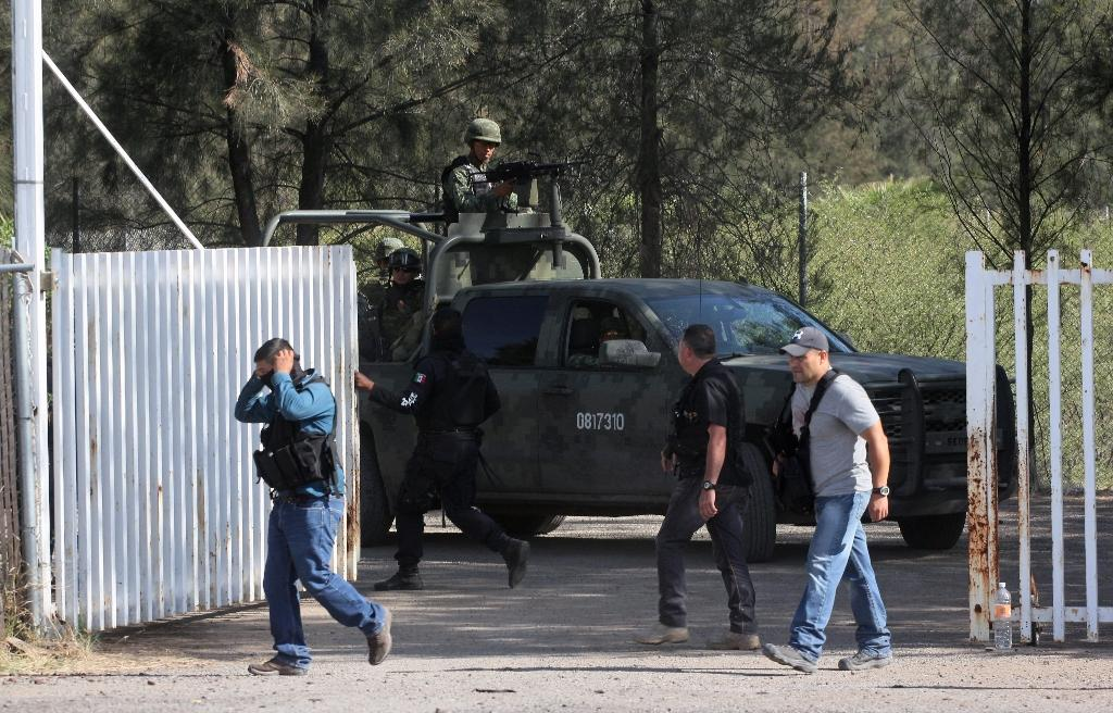 Families await 42 bodies, answers after Mexico gunfight
