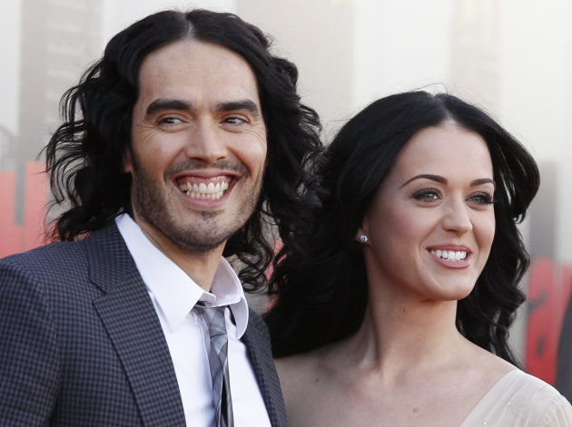 "FILE - In this April 19, 2011 file photo, British actor Russell Brand and his wife Katy Perry arrive for the European premiere of ""Arthur,"" in London. A judge signed off on the couple's divorce Wednesday, but the pair will have to wait until July 14 until they are legally single again. Financial details of the split are confidential. (AP Photo/Joel Ryan, file)"