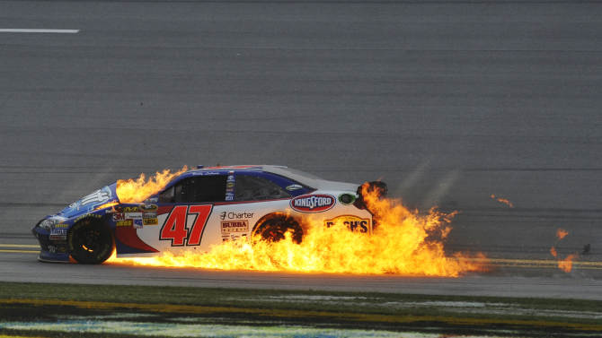 Flames engulf Bobby Labonte's car after wrecking on the last lap of the NASCAR Sprint Cup Series auto race at Talladega Superspeedway in Talladega, Ala., Sunday, Oct. 7, 2012. (AP Photo/Rainier Ehrhardt)