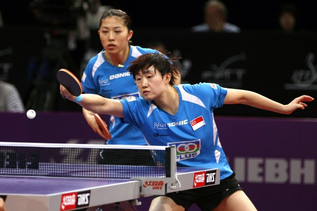 Yu and Feng of Singapore play against Guo and Li of China in their women's doubles semifinals at the World Team Table Tennis Championships in Parispionships in Paris