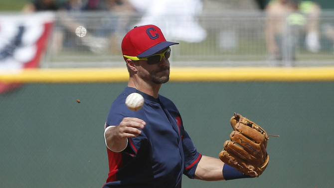 Cleveland Indians' Lonnie Chisenhall throws to first base in the fourth inning of a spring training exhibition baseball game against the Cincinnati Reds, Tuesday, March 3, 2015, in Goodyear, Ariz. (AP Photo/John Locher)