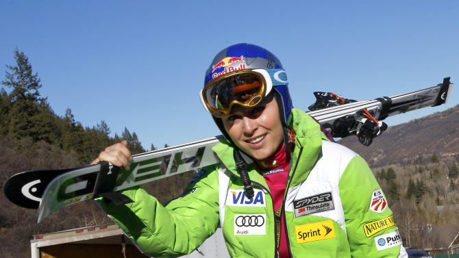 Lindsey Vonn, of the United States, carries her skis during practice for the women's World Cup ski race in Aspen, Colo. on Friday, Nov. 23, 2012. (AP Photo/Alessandro Trovati)