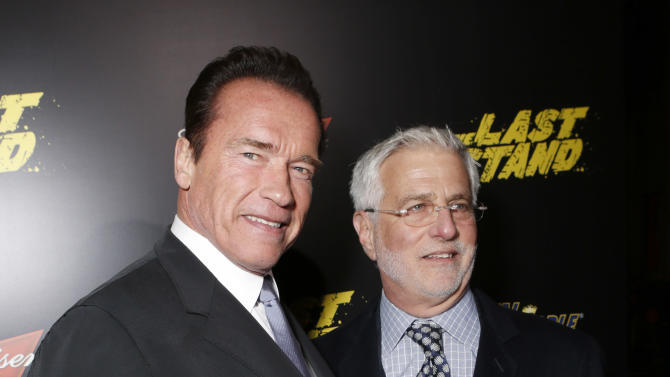 "Arnold Schwarzenegger and Co-Chairman of Lionsgate Motion Picture Group Rob Friedman attend the LA premiere of ""The Last Stand"" at Grauman's Chinese Theatre on Monday, Jan. 14, 2013, in Los Angeles. (Photo by Todd Williamson/Invision/AP)"