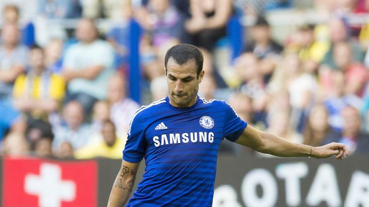 Chelsea's Cesc Fabregas scores against Vitesse Arnhem during their friendly soccer match in Arnhem