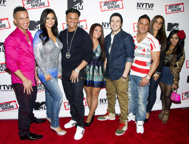 "FILE - This Oct. 24, 2012 file photo shows ""Jersey Shore"" cast members, from left, Mike ""The Situation"" Sorrentino, Jenni ""JWoww"" Farley, Paul ""Pauly D"" Delvecchio, Deena Cortese, Vinny Guadagnino, Ronnie Ortiz-Magro, Sammi ""Sweetheart"" Giancola and Nicole ""Snooki"" Polizzi at a panel entitled ""Love, Loss, (Gym, Tan) and Laundry: A Farewell to the Jersey Shore"" in New York. After three years and six seasons of boozy, rowdy wrecktitude, ""Jersey Shore"" concludes its MTV run Thursday, Dec. 20, 2012 at 10 p.m. EST. (Photo by Charles Sykes/Invision/AP, File)"