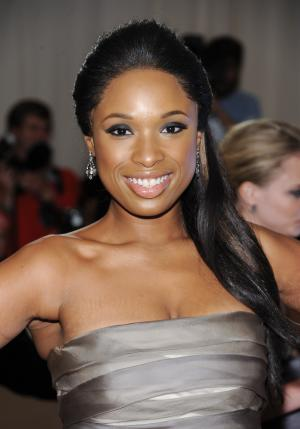FILE - In this May 2, 2011 file photo, singer Jennifer Hudson arrives at the Metropolitan Museum of Art Costume Institute gala benefit in New York.  Hudson has a deal with Dutton for a memoir about her struggles with weight and how she dropped 80 pounds. Dutton, an imprint of Penguin Group (USA) announced Tuesday, June 7, 2011, that Hudson's book will come out in January 2012. The memoir is currently untitled. (AP Photo/Evan Agostini, file)