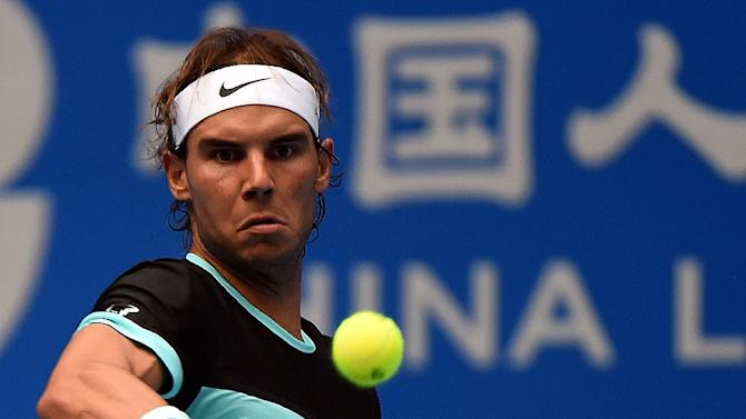 Rafael Nadal of Spain hits a return to Wu Di of China during their first round singles match at the China Open in Beijing on October 6, 2015