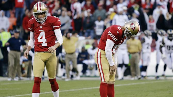San Francisco 49ers kicker David Akers (2) reacts with Andy Lee (4) after missing a 33-yard field goal during overtime of an NFL football game against the St. Louis Rams in San Francisco, Sunday, Nov. 11, 2012. San Francisco and St. Louis tied their game 24-24. (AP Photo/Marcio Jose Sanchez)