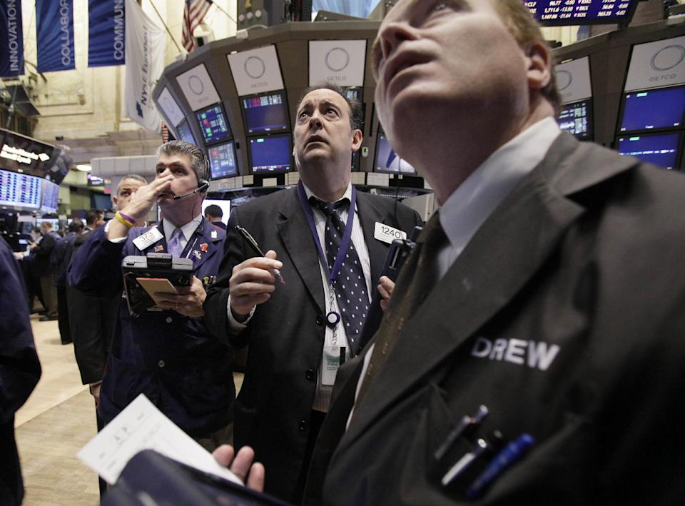 Traders work on the floor of the New York Stock Exchange Monday, Nov. 21, 2011. Stocks are taking a sharp fall in early trading Monday amid reports that a congressional committee will fail to agree on a plan to cut the U.S. government's budget deficit.(AP Photo/Richard Drew)