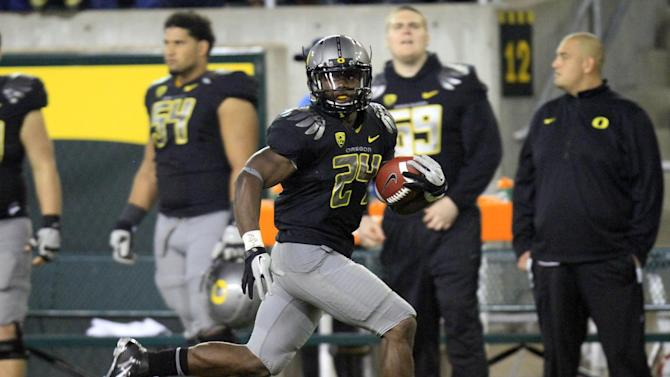 Oregon's Kenjon Barner (24) carries the ball during the first quarter of their NCAA college football game with Arizona State, Saturday, Oct. 15, 2011, in Eugene, Ore. (AP Photo/Don Ryan)