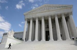 Security guards walk the steps of the Supreme Court before Justice Elena Kagan's investiture ceremony in Washington