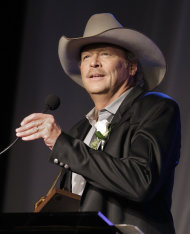 FILE -- In an Oct. 16, 2011 file photo Alan Jackson speaks as he is inducted into the Nashville Songwriters Hall of Fame on Sunday, Oct. 16, 2011, in Nashville, Tenn. Country singer Alan Jackson has raised more than $150,000 to help a Virginia county rebuild schools damaged by last year&#39;s earthquake. (AP Photo/Mark Humphrey/file)