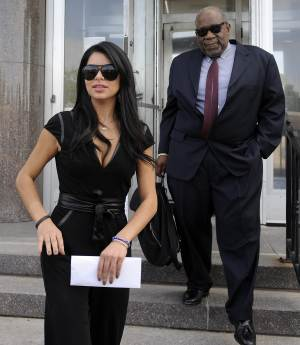 """Rima Fakih, left, and defense attorney W. Otis Culpepper leave District Court in Highland Park, Mich., on Wednesday, May 9, 2012. Fakih, the first Arab-American to be crowned Miss USA, avoided jail during sentencing Wednesday in a drunken driving case, an experience she called """"very humbling."""" (AP Photo/The Detroit News, David Coates)"""