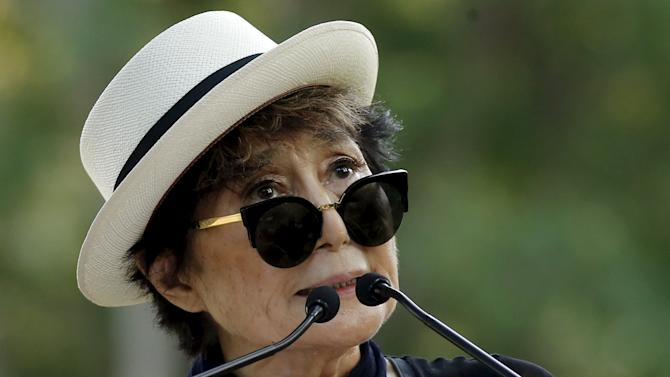 Artist Yoko Ono, the widow of John Lennon, speaks to the guests before the unveiling of a tapestry honoring Lennon at Ellis Island in New York