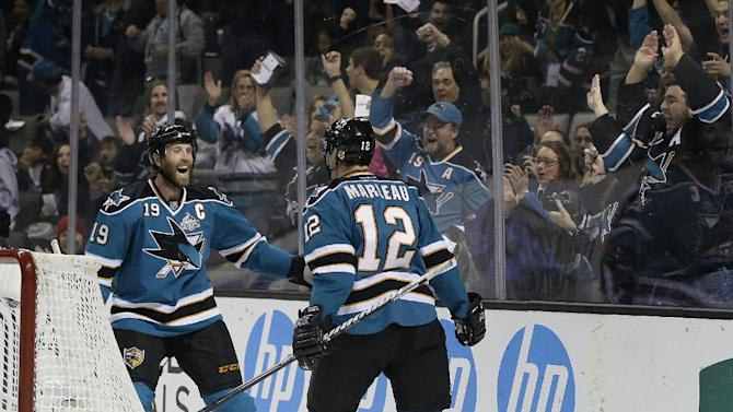 San Jose Sharks center Patrick Marleau (12) celebrates with teammate Joe Thornton, left, after scoring his second goal of the first period of an NHL hockey game against the Colorado Avalanche in San Jose, Calif., Saturday, Jan. 26, 2013. (AP Photo/Marcio Jose Sanchez)