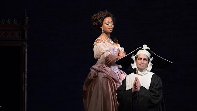 """In this Jan. 11, 2013 photo provided by the Metropolitan Opera, Juan Diego Florez, left, performs as Count Ory with Pretty Yende as Countess Adele during a dress rehearsal of Rossini's """"Le Comte Ory,"""" at the Metropolitan Opera in New York. (AP Photo/Metropolitan Opera, Marty Sohl)"""