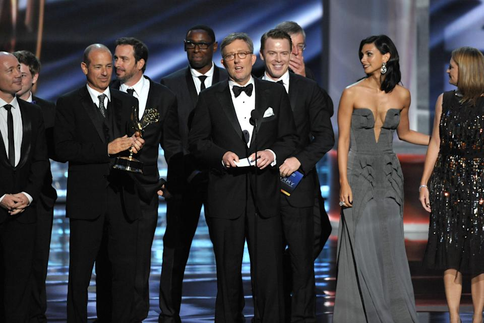 "Alex Gansa, center, and the cast and crew of ""Homeland"" accept the award for outstanding drama series at the 64th Primetime Emmy Awards at the Nokia Theatre on Sunday, Sept. 23, 2012, in Los Angeles. (Photo by John Shearer/Invision/AP)"