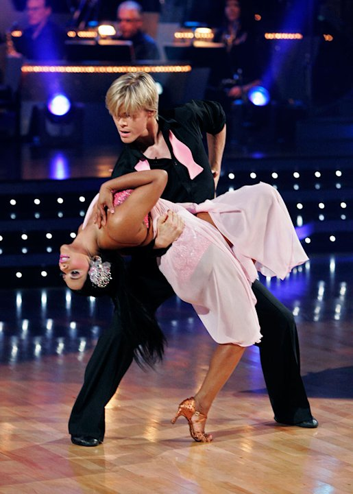 Lil' Kim and Derek Hough perform …