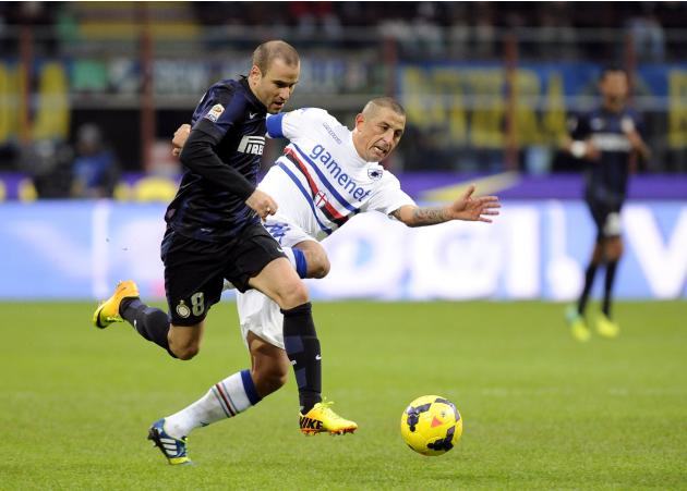 Inter Milan's Palacio is challenged by Sampdoria's Palombo during their Italian Serie A soccer match in Milan