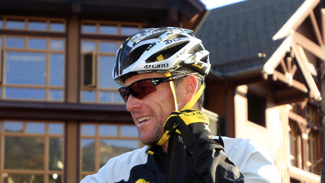 Lance Armstrong prepares to take part in the Power of Four mountain bicycle race at the starting line in Snowmass Village, Colo., early Saturday, Aug. 25, 2012. The race is the first public appearance for Armstrong since the U.S. Anti-Doping Association stripped him of his seven Tour de France championships and banned him for life from the sport.  (AP Photo/David Zalubowski)