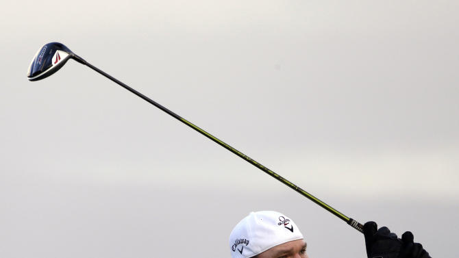 Tommy Gainey watches his tee shot off the 10th hole during the first round at the Tournament of Champions PGA golf tournament Monday, Jan. 7, 2013 in Kapalua, Hawaii. Play was scheduled to begin three days earlier, but was delayed due to weather. (AP Photo/Elaine Thompson)