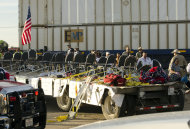 Midland police, fire and sheriffs respond to an accident where a trailer carrying wounded veterans in a parade was struck by a train in Midland, Texas, Thursday, Nov. 15, 2012. Authorities say four people are dead and 17 others are injured after a Union Pacific train slammed into the parade float. . (AP Photo/Reporter-Telegram, Tim Fischer)