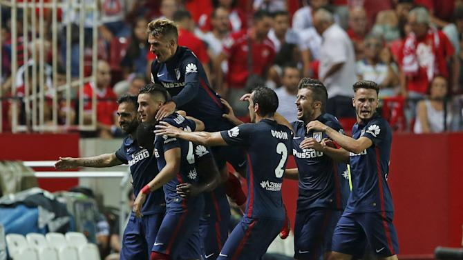 Atletico Madrid's Jackson Martinez celebrates with teammates after scoring against Sevilla during their soccer match in Seville