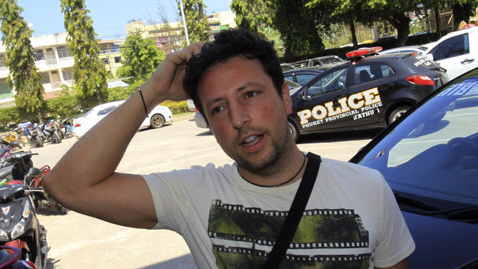 In this March 12, 2014 photo, Luigi Maraldi of Italy whose stolen passport was used by a passenger boarding a missing Malaysia Airlines plane, talks to a reporter at Phuket police station in Phuket province, southern Thailand. Maraldi lost his passport when he hired a motorbike on Phuket last year. When he returned to the shop to retrieve his passport, he was told it had been given away to someone who looked just like him. His passport, along with another stolen in Phuket two years earlier, was used to board the ill-fated flight from Kuala Lumpur to Beijing undetected, revealing startling shortcomings in the security of international travel. Interpol said it maintains a global database of 40 million lost or stolen travel documents. The organization said only a handful of countries actually check the database before allowing passengers to board international flights. Malaysia and Thailand are not among them. (AP Photo/Sakchai Lalit)