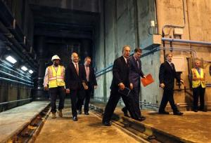 New York City Mayor Michael Bloomberg walks in a tunnel some 200 feet below New York City's Central Park to announce the completion and activation of the Manhattan portion of the city's third water tunnel (Tunnel No.3)