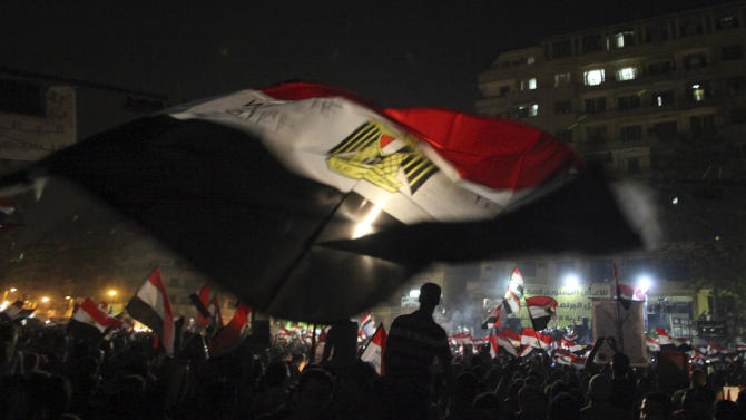 """Egyptians celebrate the victory of Mohammed Morsi in Tahrir Square, Cairo, Egypt, Monday, June 25, 2012. The Muslim Brotherhood's Mohammed Morsi was declared the winner of Egypt's first free presidential election Sunday, and he proclaimed himself a leader """"for all Egyptians,"""" although he faces a struggle for power with the country's still-dominant military rulers. (AP Photo/Thomas Hartwell)"""