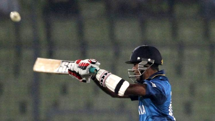 Sri Lanka's Perera plays a ball against India during their warm-up match of ICC Twenty20 World Cup in Dhaka