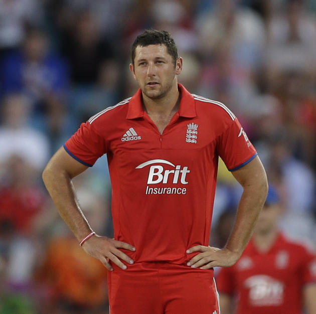 England's Tim Bresnan looks on after West Indies' Darren Sammy hit a six during their second T20 International cricket match at the Kensington Oval in Bridgetown, Barbados, Tuesday, March 11,