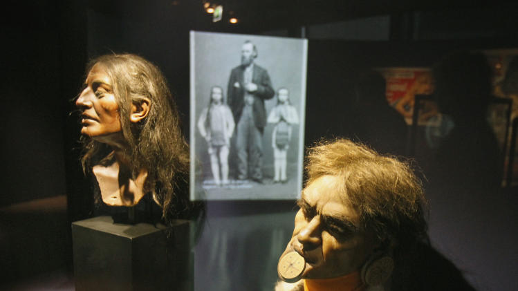 Nineteenth century models of heads of a Botoduco man are shown at a new exhibition at the Quai Branly museum in Paris, Monday Nov. 28, 2011. Until less than a century ago, white people regularly put Africans, native Americans or Pacific islanders on display in circuses, expositions and shows. A new Paris exhibit, curated by former football star and anti-racism advocate Lilian Thuram, examines how this demeaning colonial-era tradition shaped attitudes that still linger today.(AP Photo/Remy de la Mauviniere)
