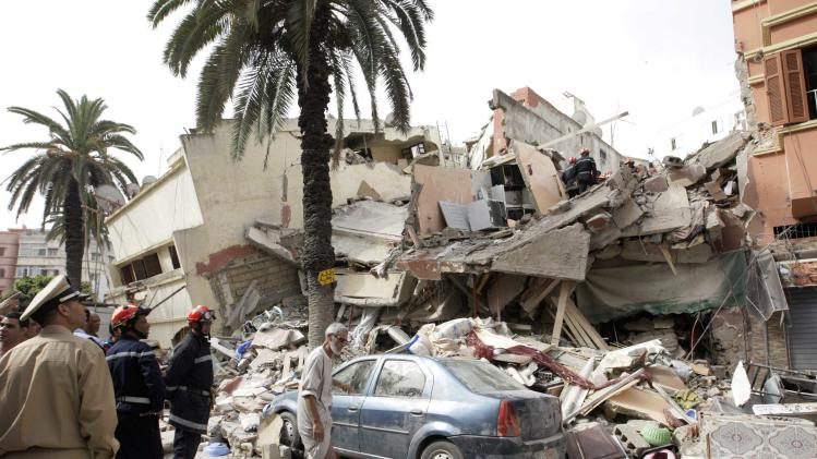 Firefighters search for victims under the rubble after buildings collapsed in downtown Casablanca