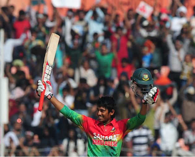 Bangladesh cricketer Anamul Haque reacts after scoring a century (100 runs) during the second one day international cricket match between Bangladesh and the West Indies at the Sheikh Abu Naser Stadium