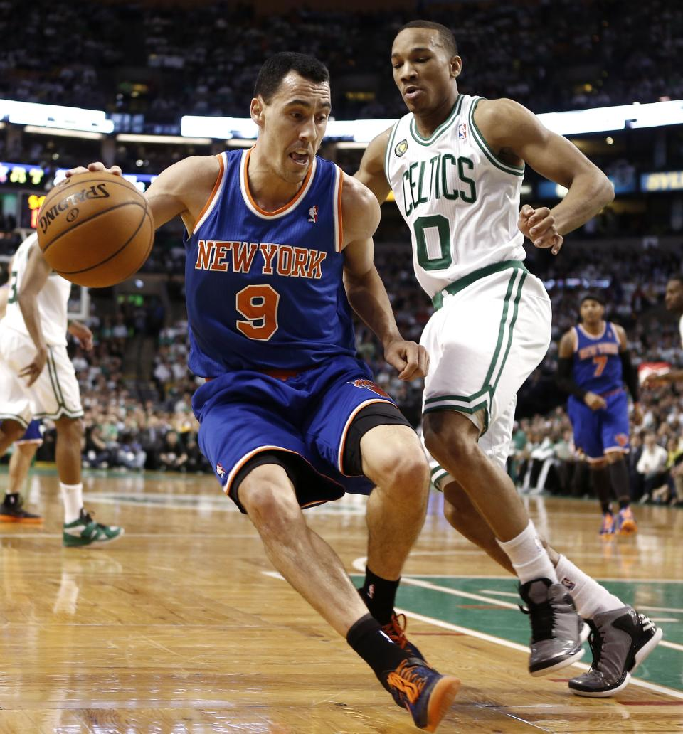New York Knicks point guard Pablo Prigioni (9) looks to get around Boston Celtics' Avery Bradley during the second quarter of Game 3 of a first-round NBA basketball playoff series in Boston, Friday, April 26, 2013. (AP Photo/Winslow Townson)