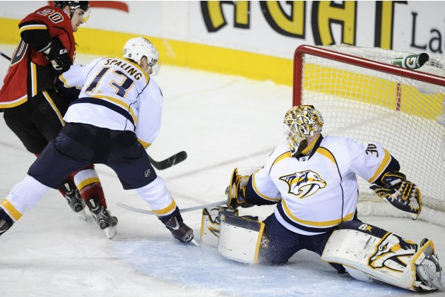 Calgary Flames' Glencross puts the puck past Nashville Predators goalie Mason during third period NHL game in Calgary